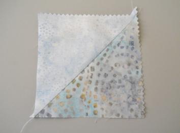 two charm squares sewn on the diagonal